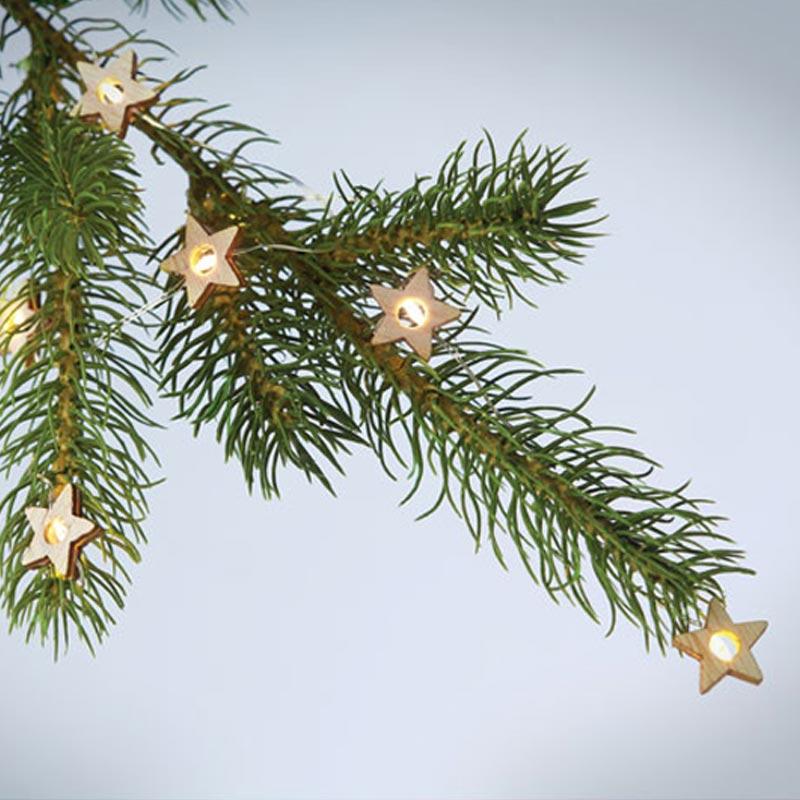 Guirlande étoile lumineuse dans sapin