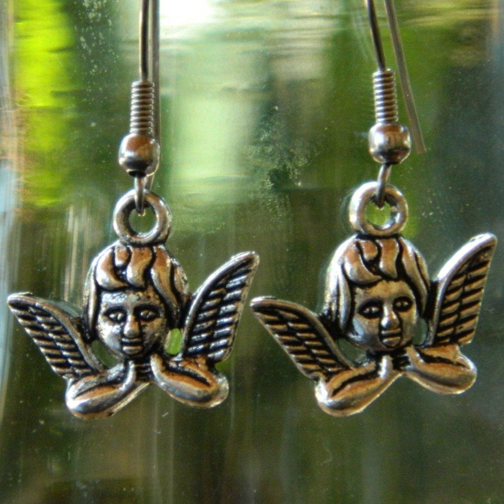 Boucle d'oreille ange en métal