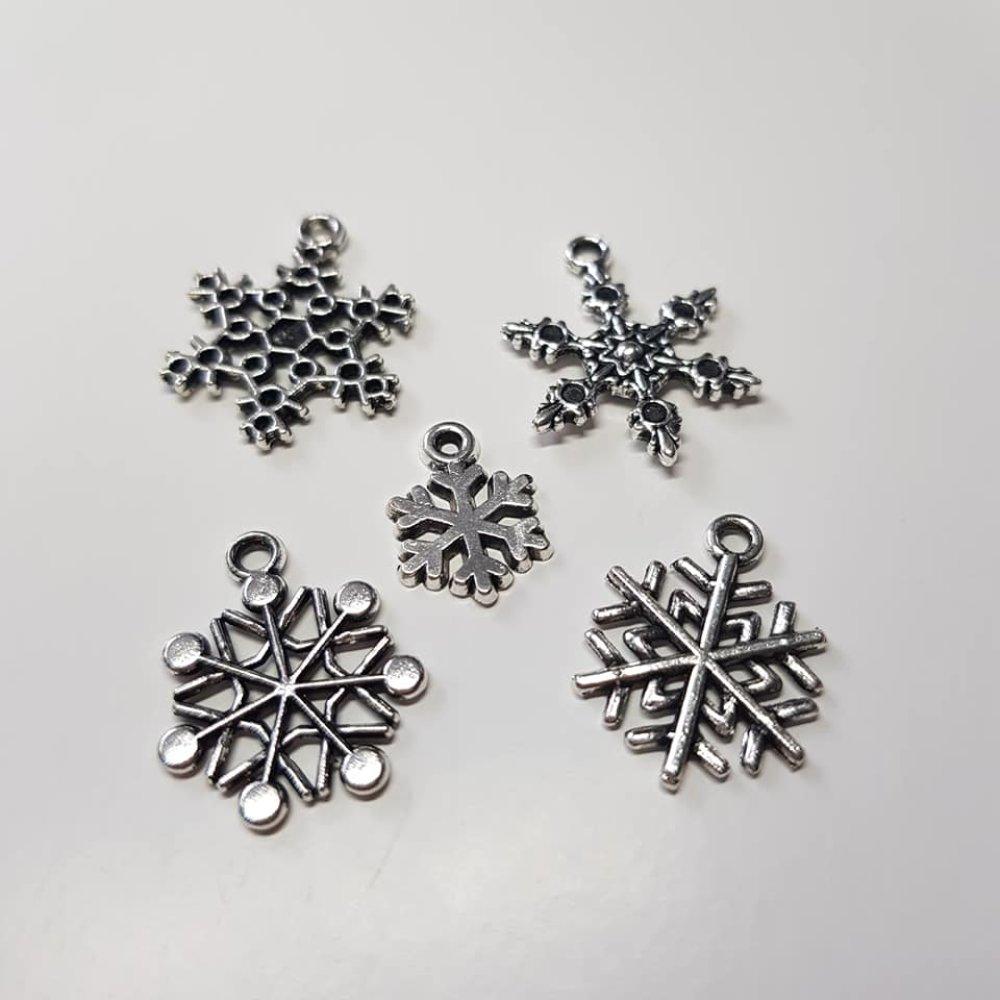 Petite étoiles des neige en métal argenté