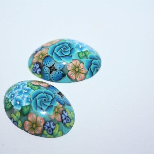 Deux cabochons ovales en polymère, fleuri bleu orange