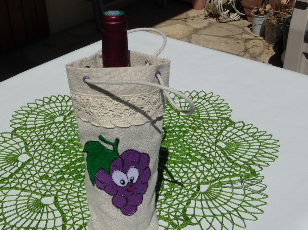 Sac porte bouteille en lin avec motif grappe.