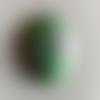 1 cabochon de pierre couleurs variées en pierre naturelle. 25 x 18 mm.