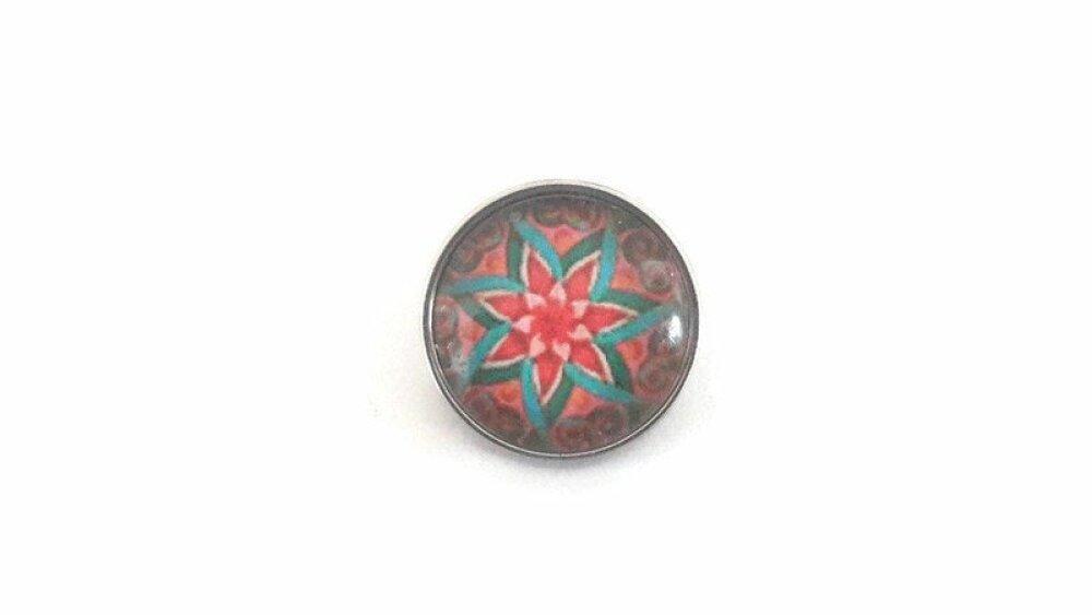 bouton pression à cabochon de verre   abstrait aux tons bleu et rouge
