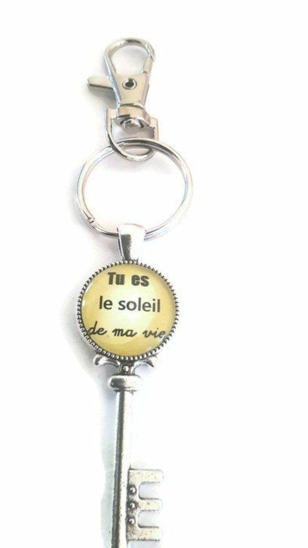 """Porte clé à cabochon de verre 18mm à message """"tu es le soleil de ma vie"""""""
