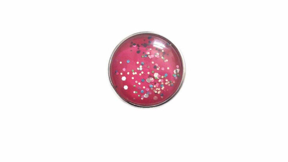 bouton pression à cabochon de verre  rose à paillettes multicolores