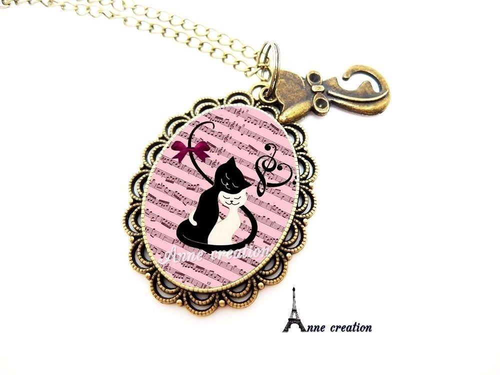 boucle d'oreille les amoureux chat noir chat blanc partition