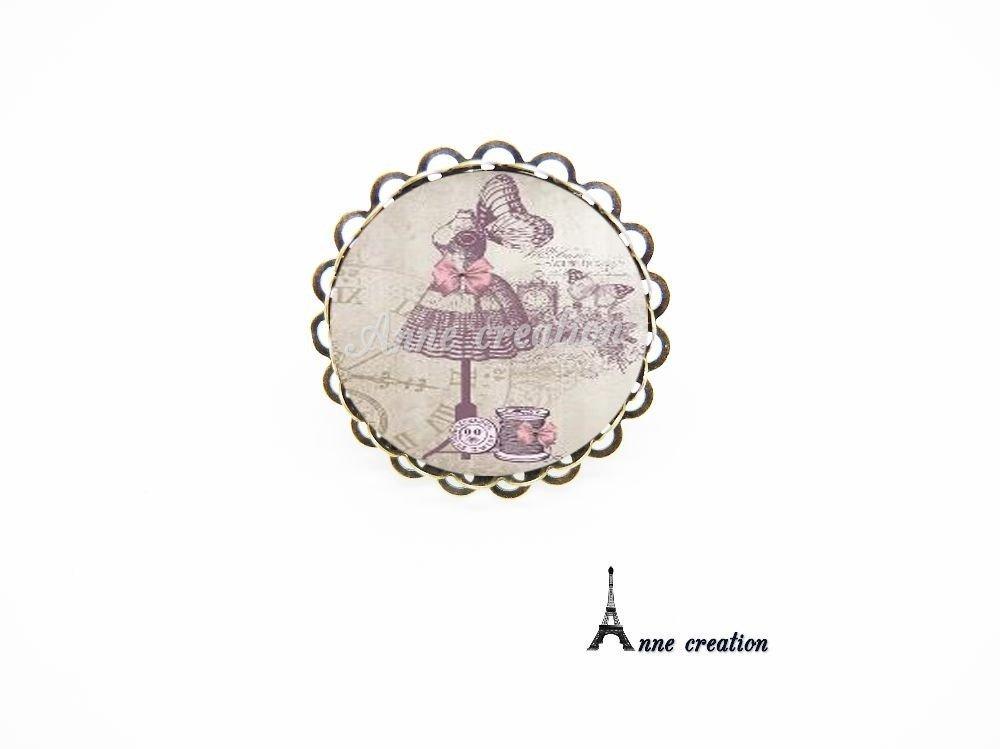 collier mannequin de couture bobine de fil bouton