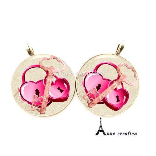 Boucle d'oreille cadenas coeur grande clé rose