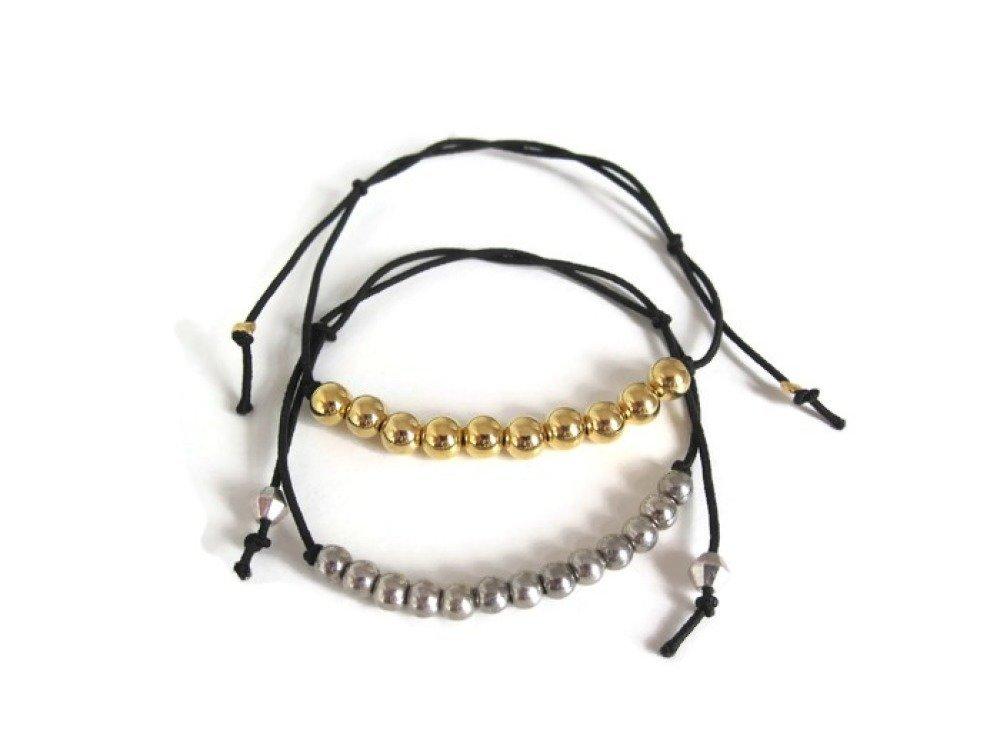 Bracelet élastique noir et perles dorées ou argentées