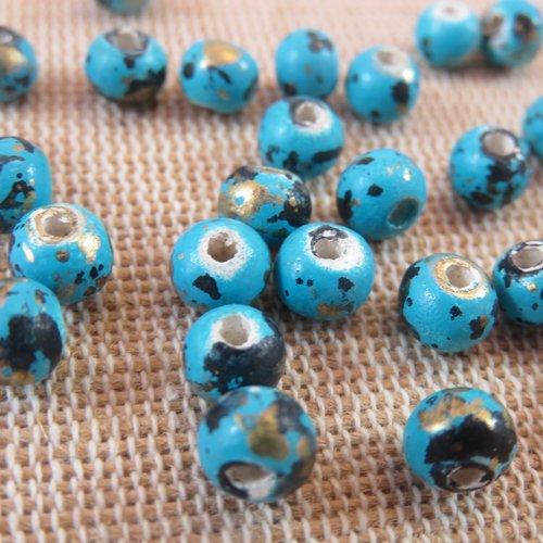 Perles ronde 6mm en bois bleu tacheté - lot de 20