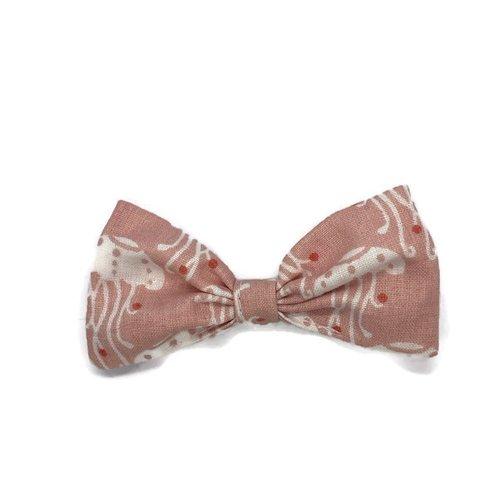 Barrette à cheveux rose à méduses blanches