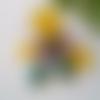 Boucles d'oreilles recto verso gouttes fleurs verte et jaune en pâte polymère