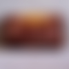 Blague à tabac en cuir marron foncé décorée de loups