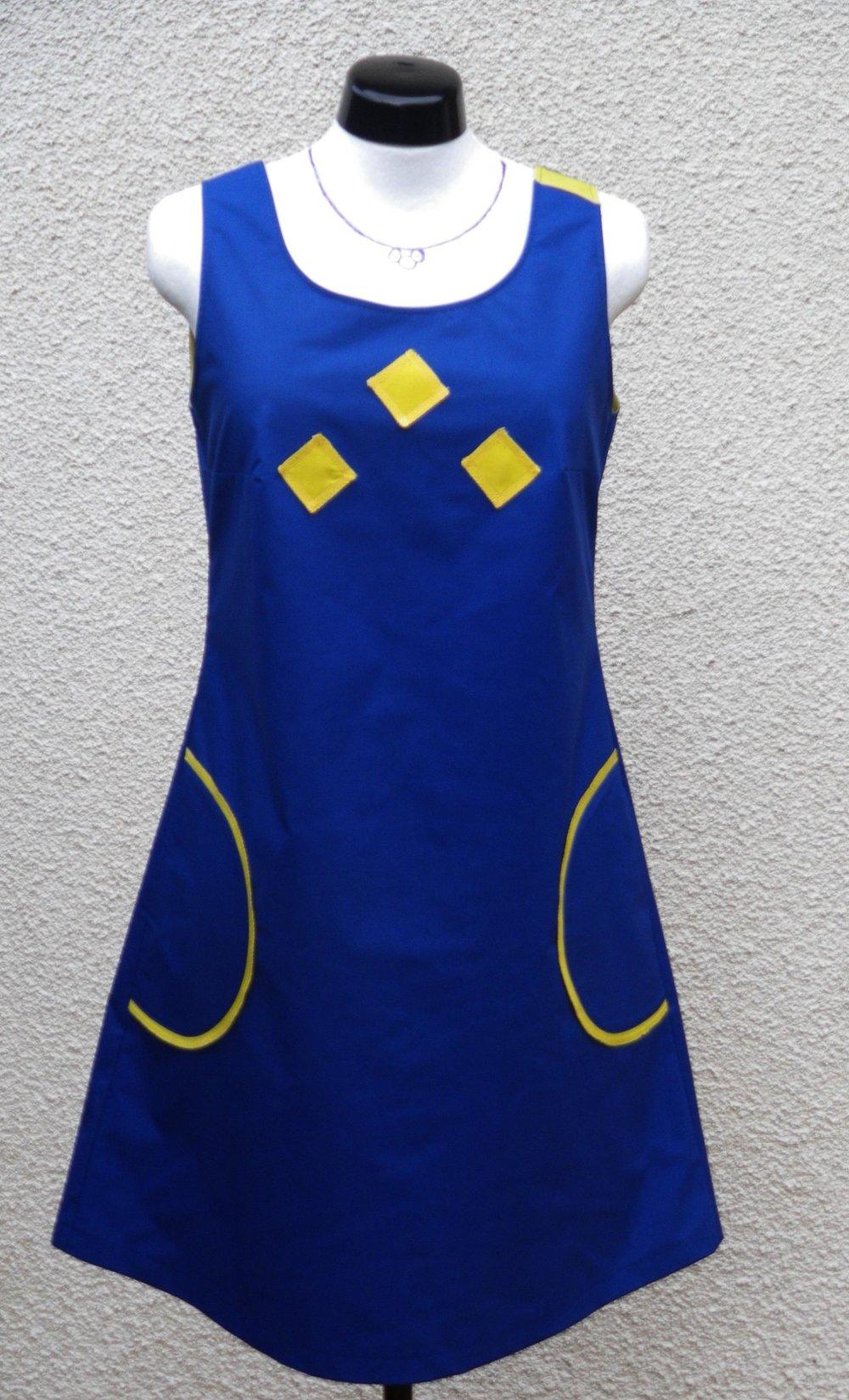 Robe femme, forme trapèze, semi-ajustée, 2 poches , zip apparente milieu dos.