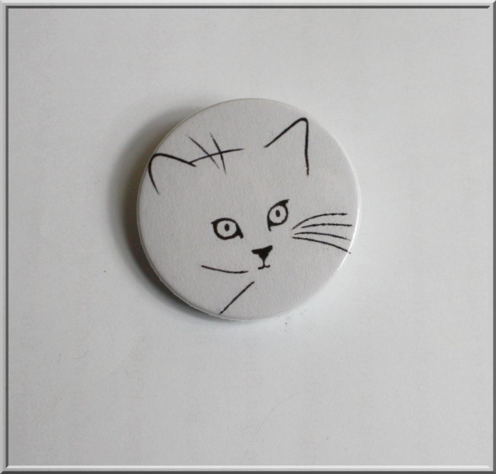 Badge : tête de chat