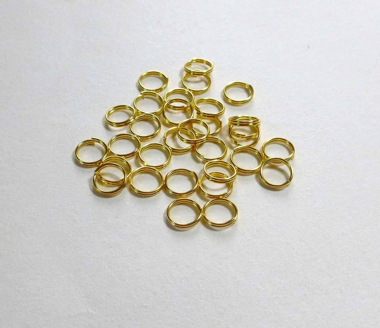50 anneaux 8mm de jonction doré double