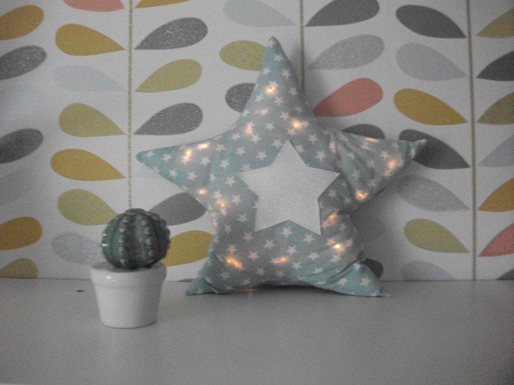 Coussin lumineux en forme d'étoile
