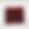 Trousse en coton imprimé liberty avec des coquelicots rouges sur un fond bleu noir