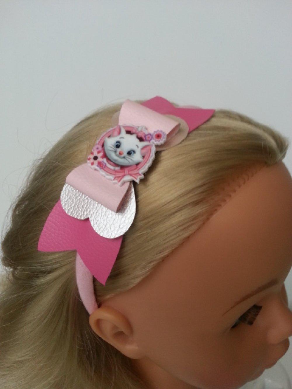 serre tête avec noeud simili cuir rose et gris cabochon marie aristochat