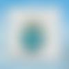 Snap bouton pression fond bleu avec petites étoiles colorées