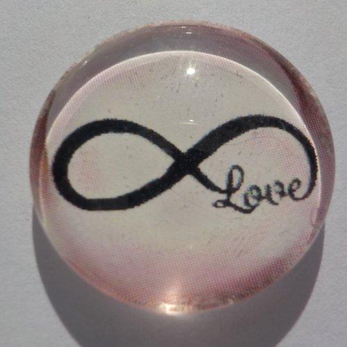 Cabochon de verre, avec son image signe de l'infini rose