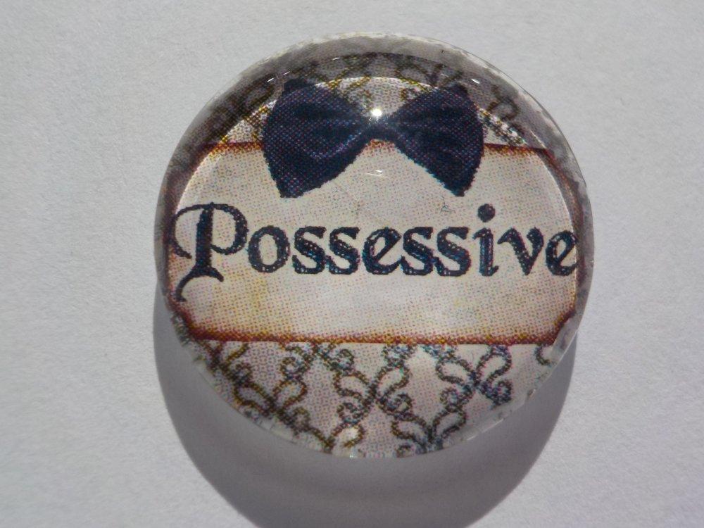 Cabochon de verre possessive