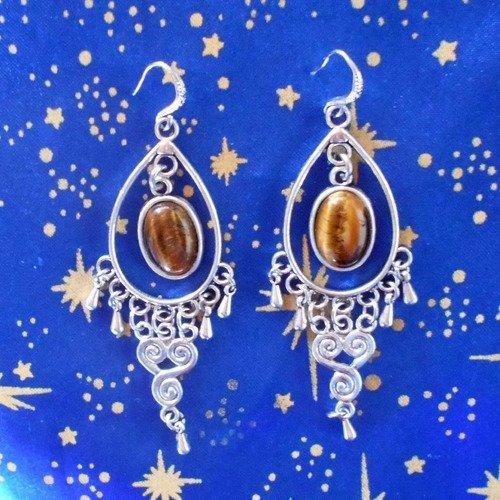 Boucles d'oreilles en alliage argent/étain, motif tourbillons, avec oeil de tigre de 10x14mm.