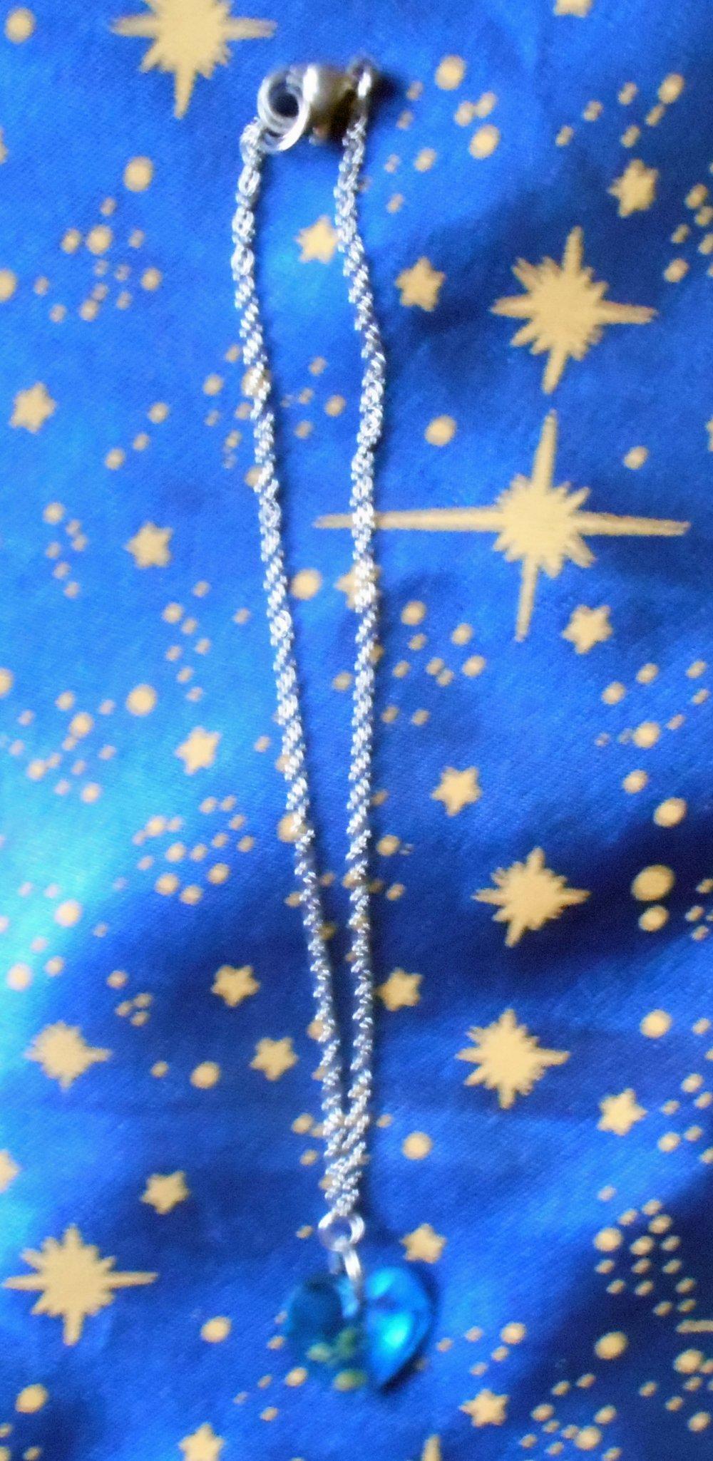 Chaîne de cheville en inox avec cristal de swarovski forme coeur turquoise de 12mm.
