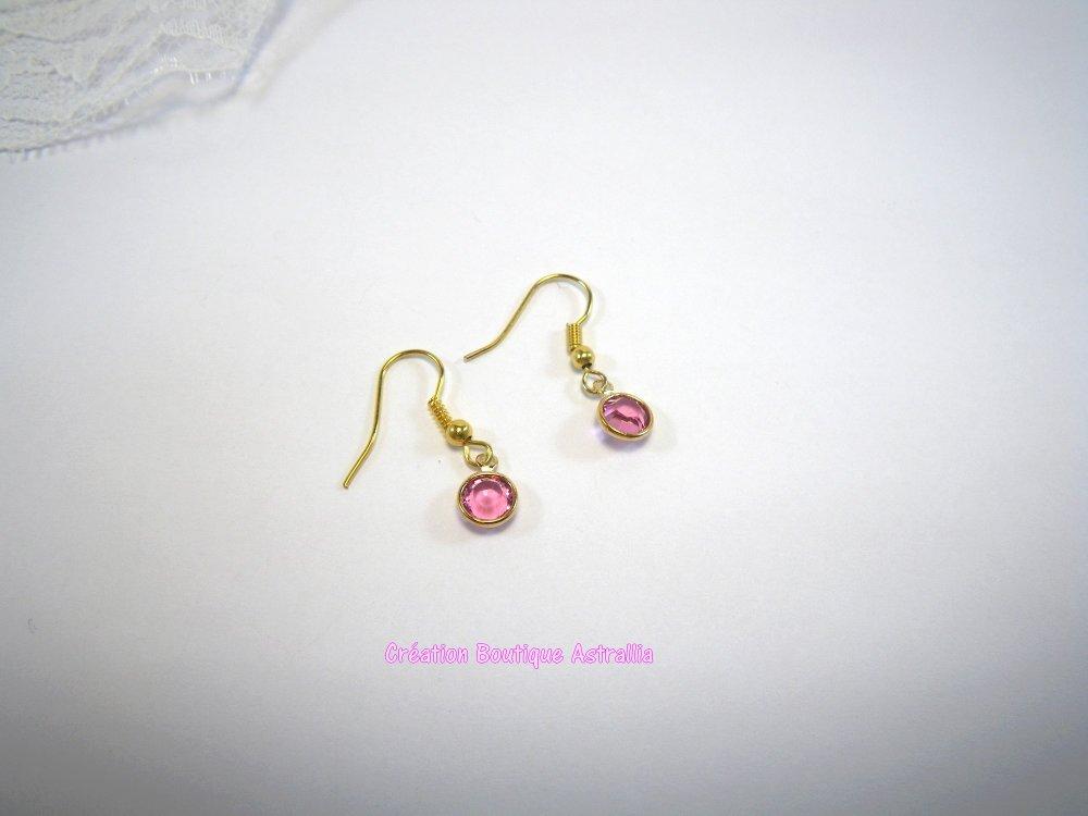Boucles d'oreilles en perle de verre rose forme ronde facettée