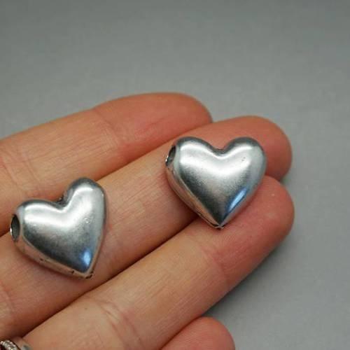 E28 perle passant cuir coeur pour cordon 3mm