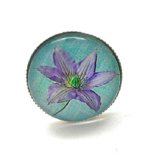 Bague argentée, fleur mauve sur fond turquoise par breloques et cie
