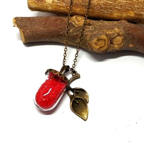 Sautoir globe en verre sable épais rouge, breloque arum