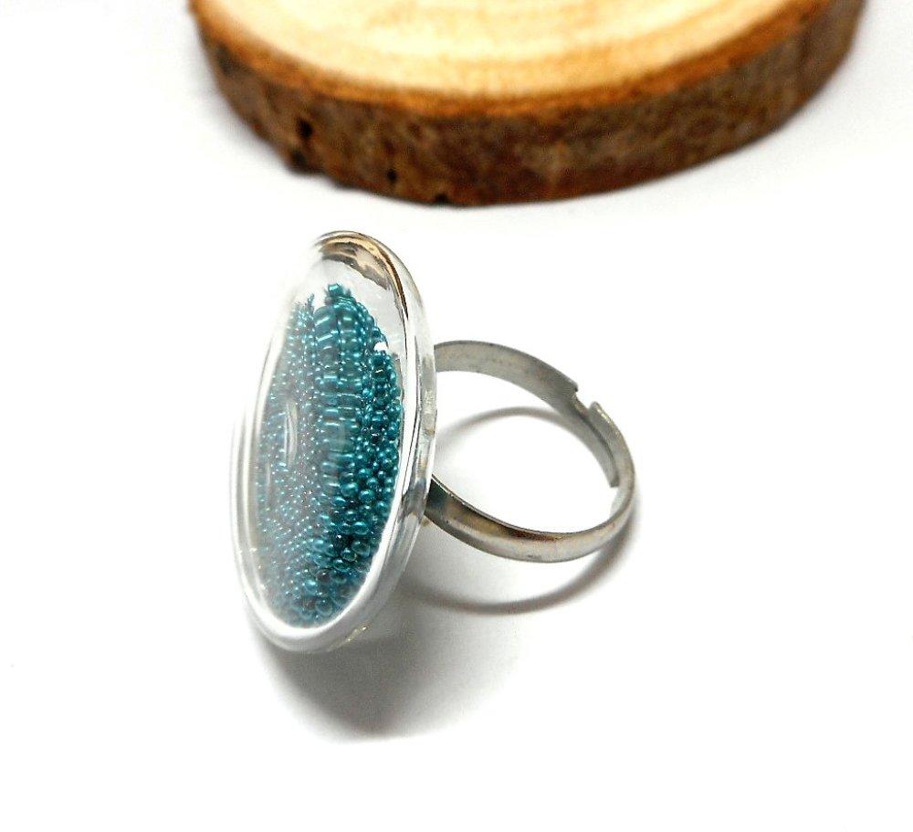 Bague globe en verre microbilles turquoises par breloques et cie