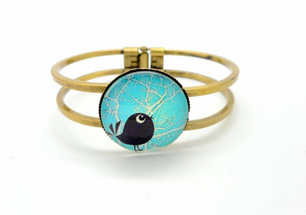 Bracelet fantaisie rigide bronze, oiseau sur fond turquoise