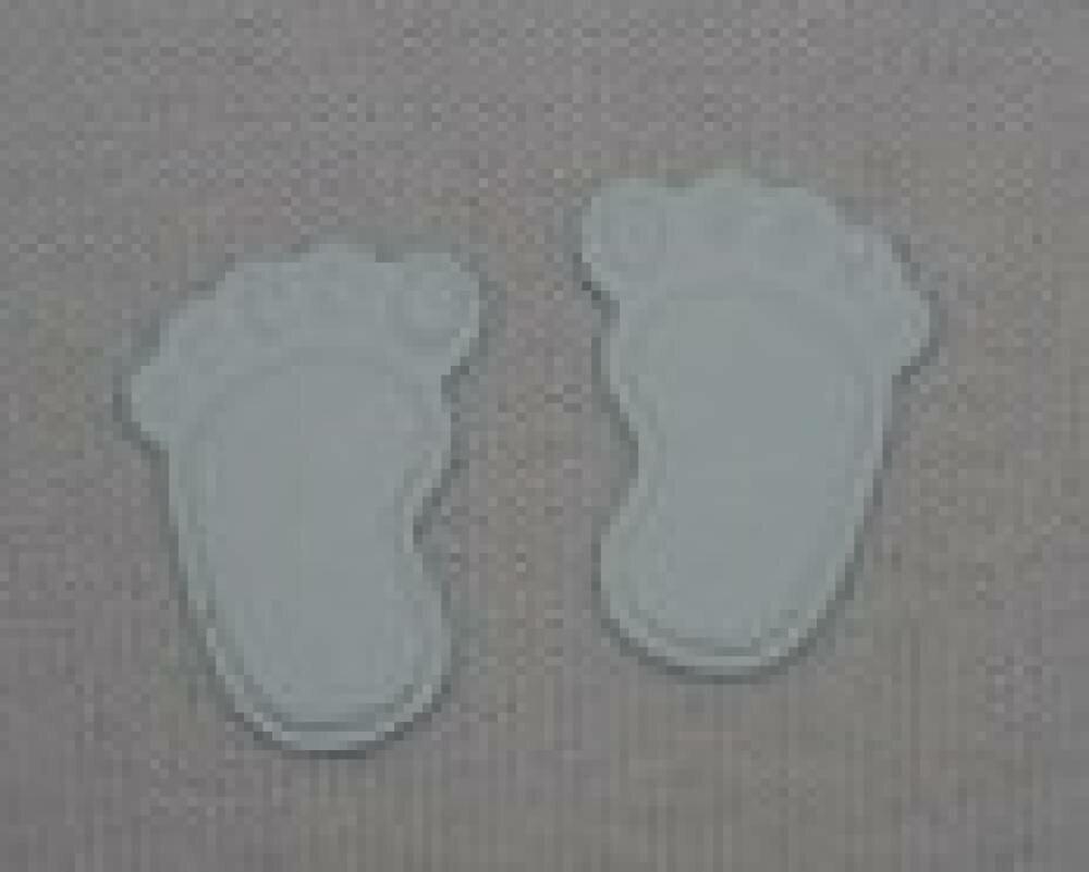 n°7 d'une paire de pieds  en papier bleu pale    découpage et gaufrage