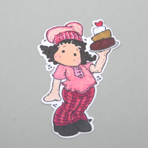 N° 2058 découpe d'une  petite fille  cuisinière gâteau  n°31 colorée avec un tampon encre noir  sur  papier blanc