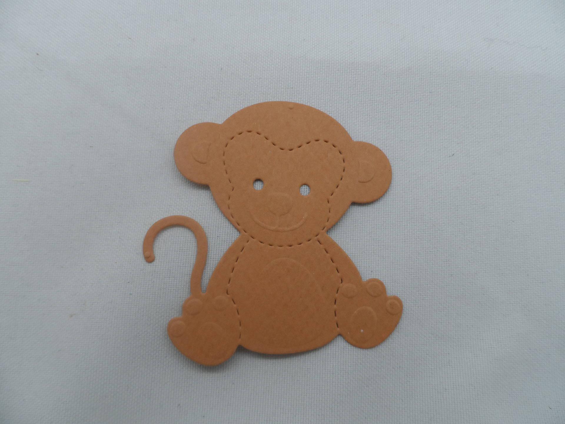 n°758 petit singe  en  papier  marron  découpage et gaufrage