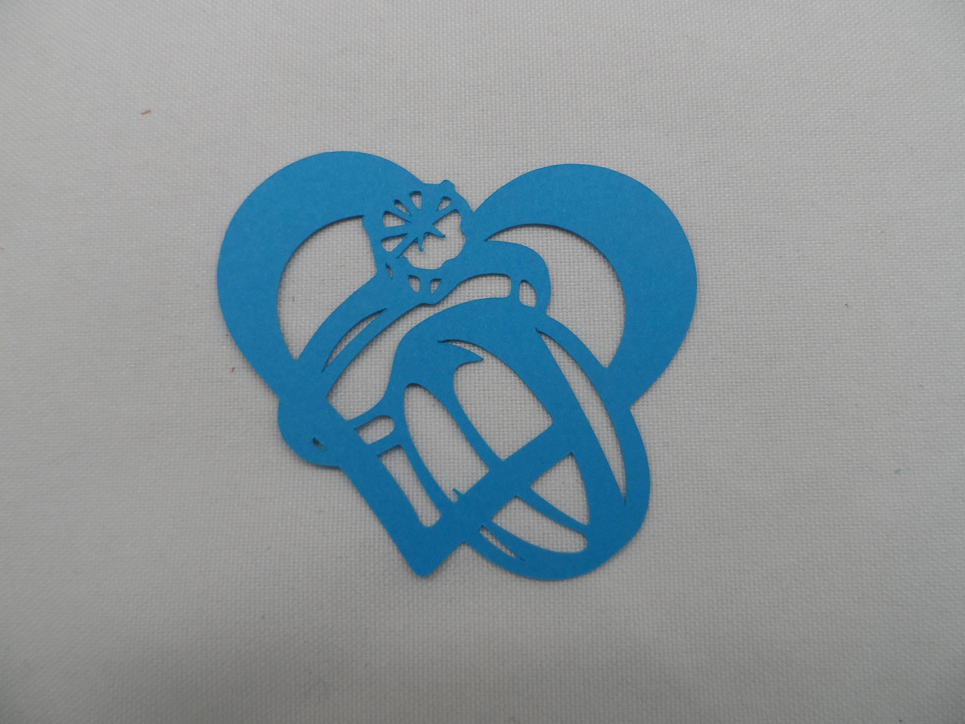 n°203 d'un cœur entrelacé avec deux bagues une alliance et alliance avec un diamant   en papier  bleu