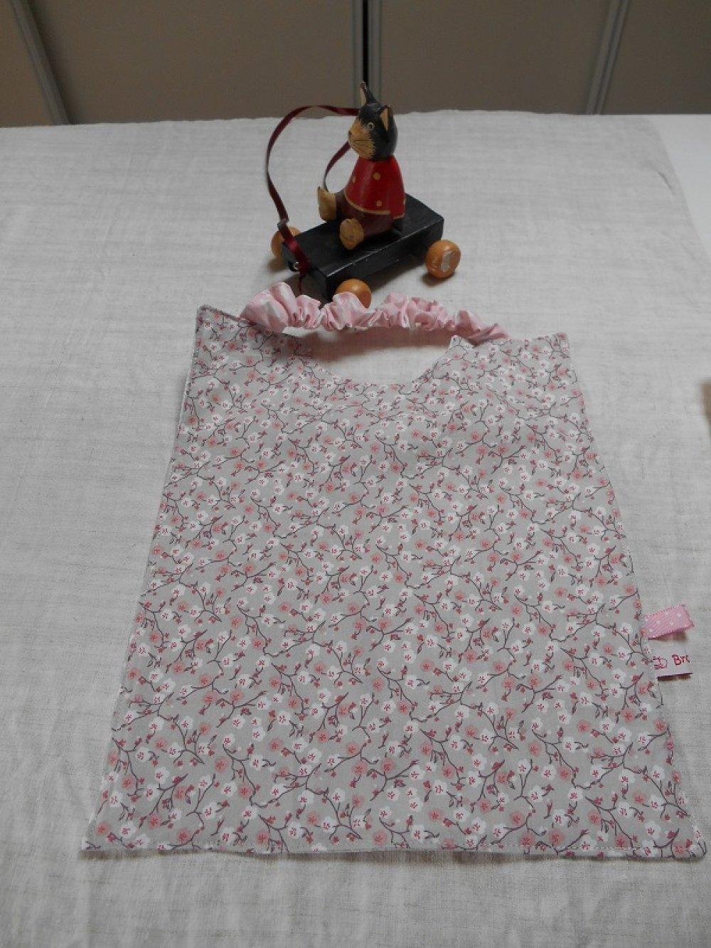 Serviette à élastique imprimée de fleurs de cerisier, fond gris léger