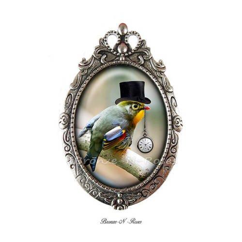 """Broche épingle """" steampunk bird """" cabochon oiseaux chapeau noir montre"""