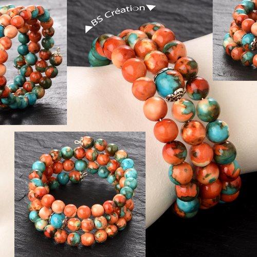 Bracelet à mémoire de forme, perles rondes en jade blanc teint, monté sur fil acier carbone.