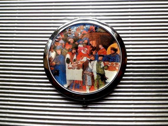 grand miroir de poche :les riches heures du duc de Berry ,le repas