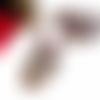 Collier grand pendentif tête de mort, calavera, fleurs, perles rondes rouges et perles toupies en cristal swarovski siam et jet