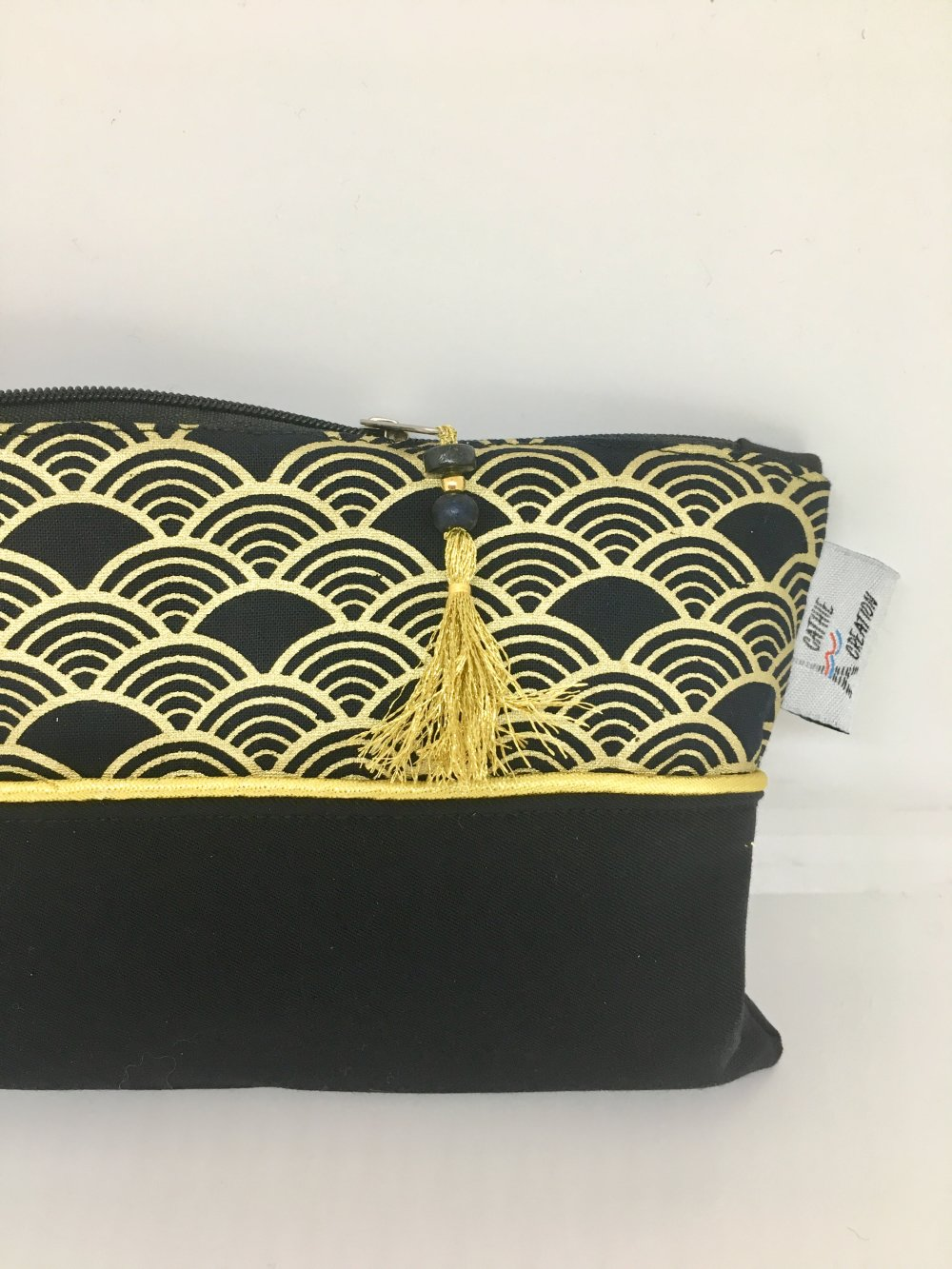 Pochette maquillage noir et or tissu motif japonais