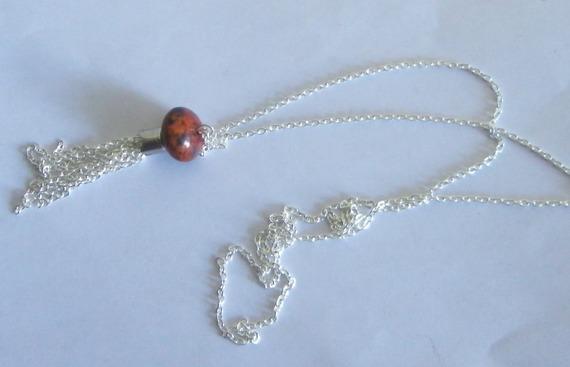 collier sautoir perle soucoupe marron orangé-brun sur chaine maillon