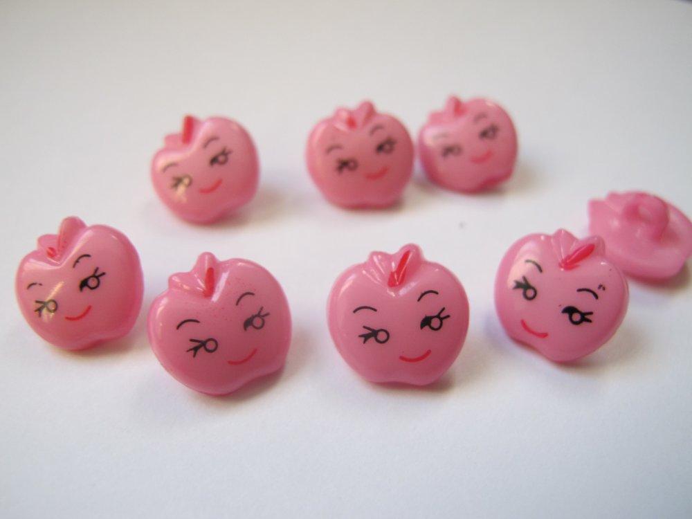 Bouton pomme avec visage rose clair