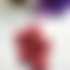 Lot de 6 perles effet vieilli en acrylique tete de mort rouge