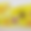 Ruban jaune coeurs et fleurs en polyester (x 1 mètre)