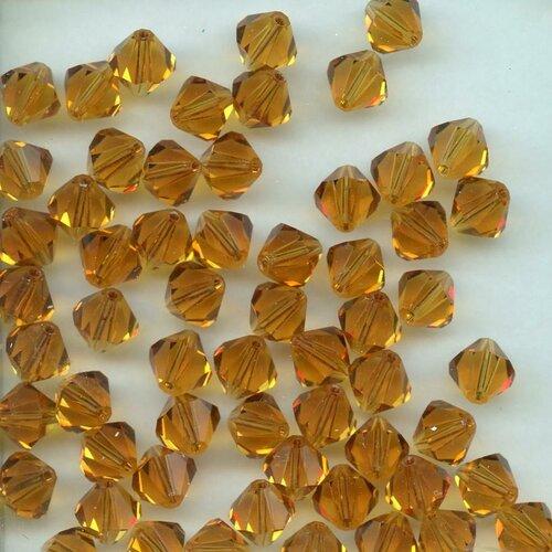 T5 5301 Y *** 20 toupies cristal Swarovski 5mm LIGHT TOPAZ