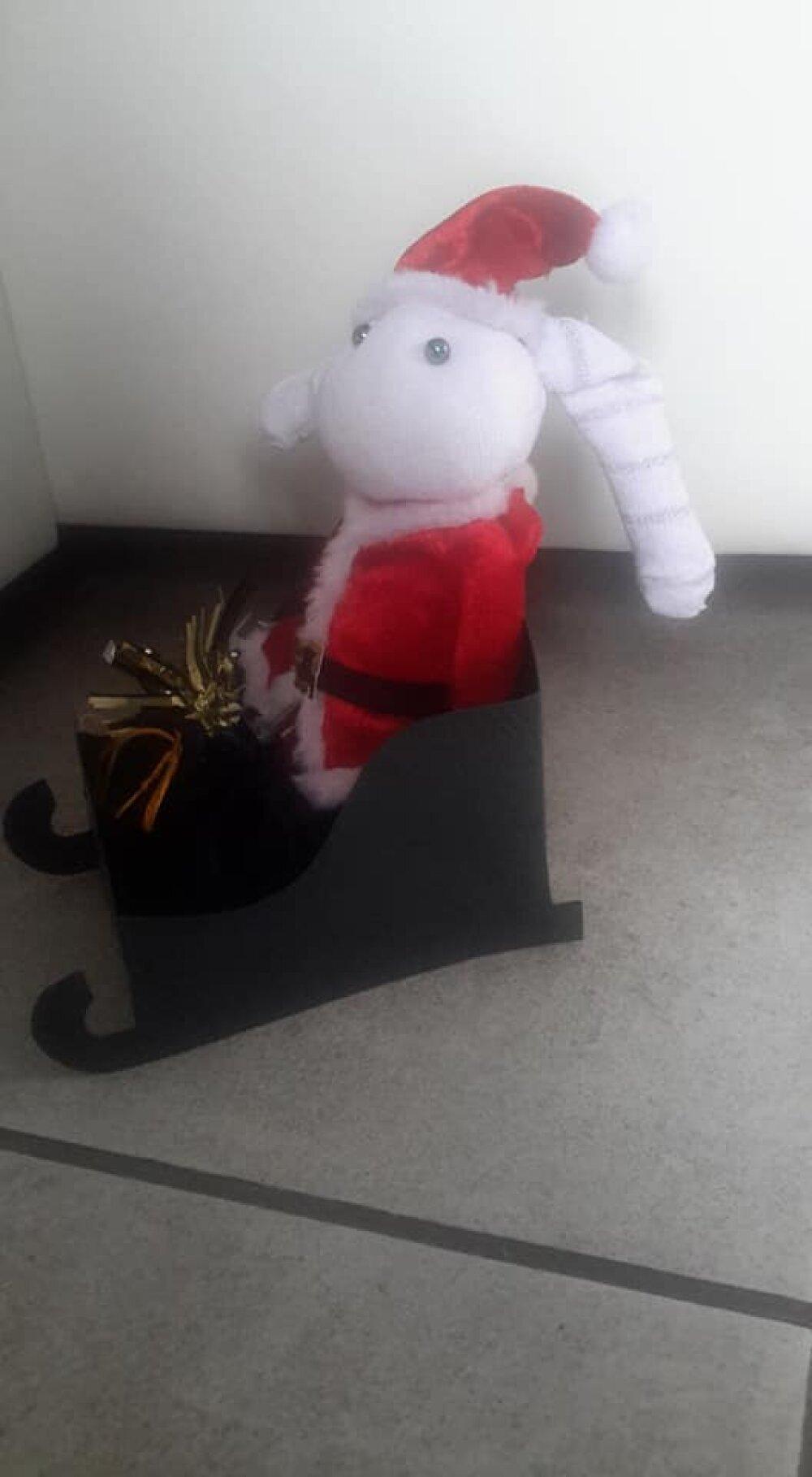 Lapin Noël chaussette avec son traîneau et sa hotte de papillotes